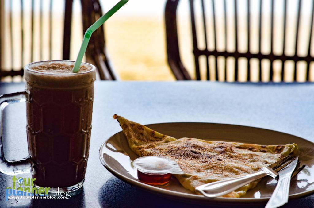 Enjoying Banana Pancake with honey and Chocolate shake at Palolem beach